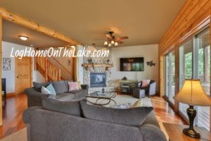 """Open Main Floor Family Room with Fireplace, 60"""" TV, glass doors to deck and lake."""